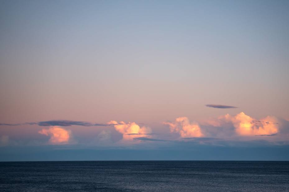 cloudy sky over rippling sea